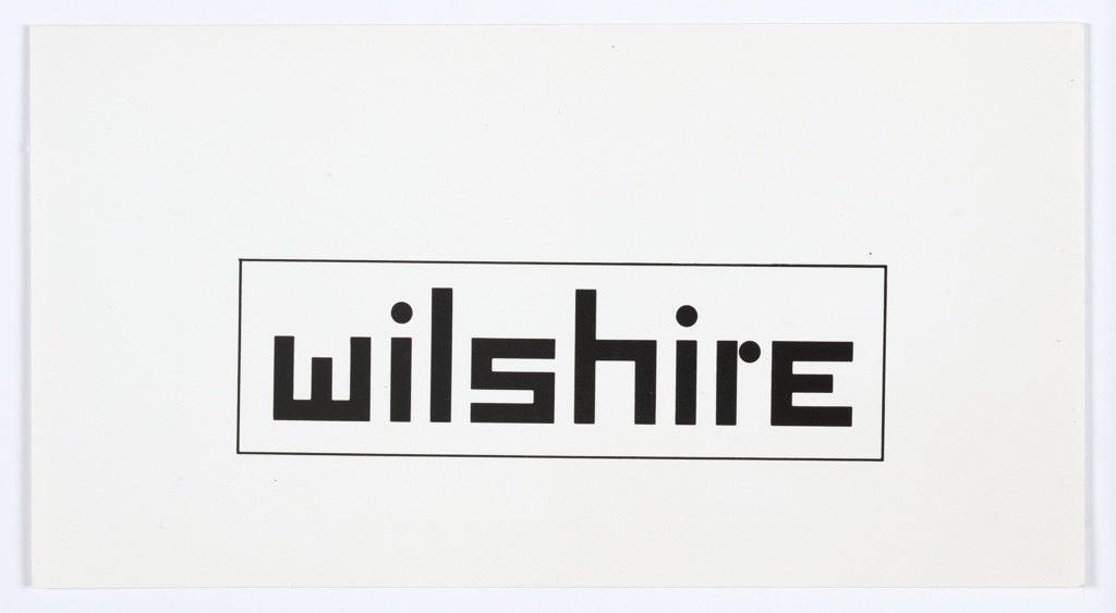 """Logo design with """"wilshire"""" printed in black angular text, surrounded by a black rectilinear border."""