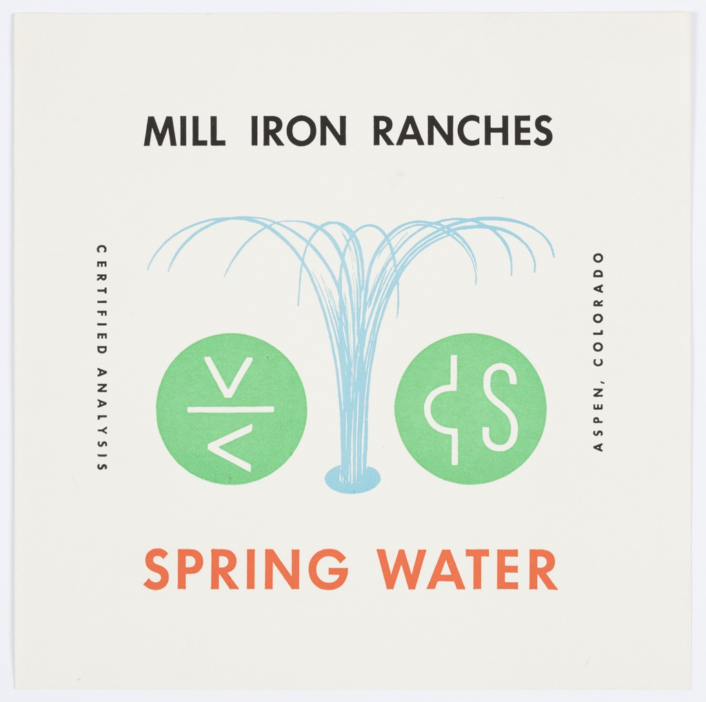 """Label for Mill Iron Ranches Spring Water. Consists of the black text, """"MILL IRON RANCHES"""" printed in black along the top, with """"SPRING WATER"""" in red at bottom. Water is spewing outwards in the center, with green circles on either side containing white symbols inside. Printed in black, vertically, left: CERTIFIED ANALYSIS; right: ASPEN, COLORADO."""