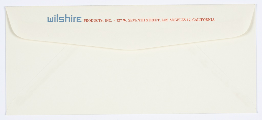 Envelope for Wilshire Products, Inc. featuring typographic graphic identity in embossed blue at left, printed address in red at right.