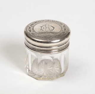 Smallest glass bottle with silver top, part of set.