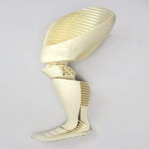White nylon prosthetic leg, spanning mid-thigh to foot; hollow form, jointed to bend at knee and foot.