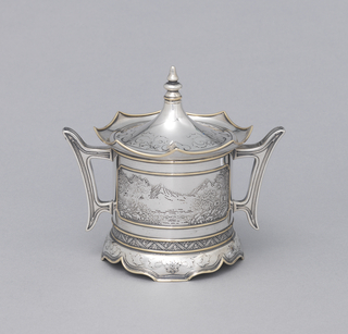 Squat cylindrical form with applied gold edges and chased with elaborate Chinese landscapes; two handles. Tapering conical lid with stepped knop.