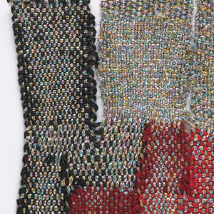 A composition of tabs of varying widths and irregular rectangles of color in black, maroon, red, and metallic silver.