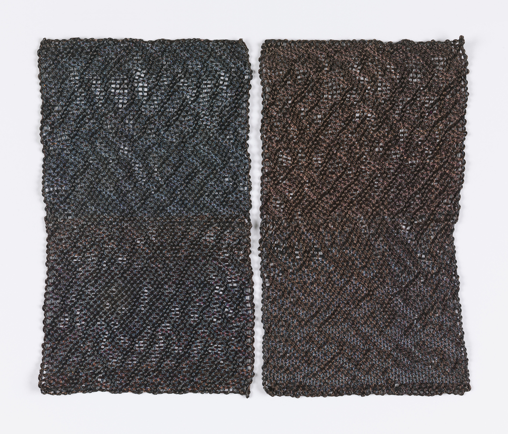 Two rectangles, each with an all-over vine-like texture in subtly varied colors of dark blue and brown. The yarns are not dyed; the color variation is caused by changes in the molecular structure of the steel through sequential heating and cooling.