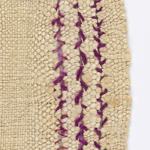 Loosely twisted natural silk woven with slits which are darned closed with plum mohair.