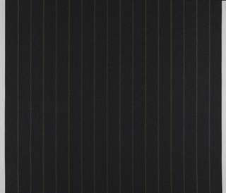 Dark gray mottled wool-blend ground with stitched vertical zigzag stripes of olive green and lighter gray. Stripes are spaced approximately three inches apart.
