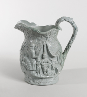 Glazed pitcher in gray-green with relief decoration depicting family gathered under canopy, which sheet at feet; all over foliage pattern.