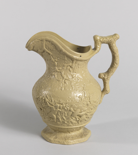 Green putty colored bulbous pitcher with scene in relief depicting Roman style battle.