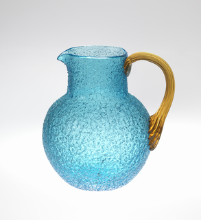 Peacock blue crackle glass body of globular form with cylindrical neck; applied striated golden-yellow loop handle.