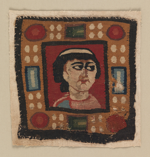 Square of wool tapestry containing an almost frontal bust of a woman with dark hair knotted at the back, gazing to her left, on a red ground. Broad frame imitating gold set with cabochons and rectangular faceted jewels in blue, green, red and white. The woman is wearing a pink garment with perhaps a mantle of sky blue on her right shoulder; she wears a white band in her hair, which is mingled dark blue and brown wefts.