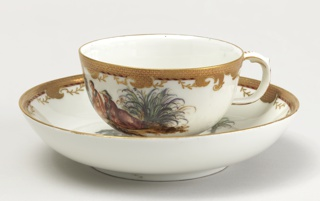 Cup and Saucer with Chinoiserie Vignettes Cup And Saucer