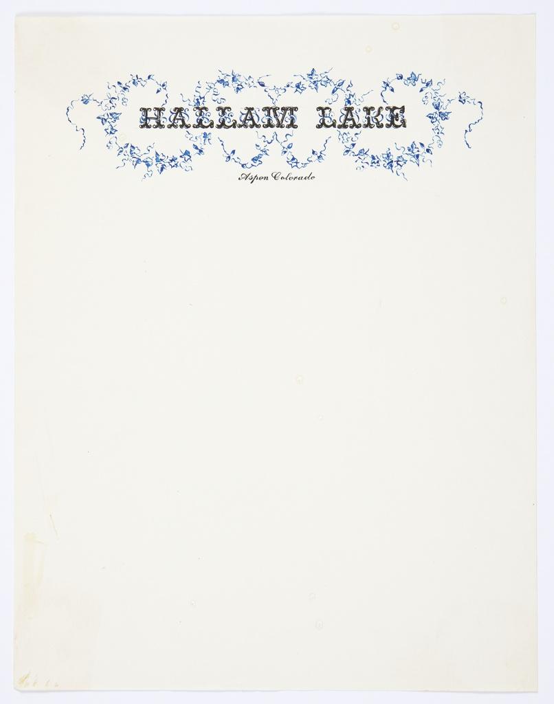 Hallam Lake letterhead. At top center, in black printed curling text: HALLAM LAKE. Curling arrangements of blue leaves swirl around this heading. In small printed black cursive text below: Aspen Colorado.