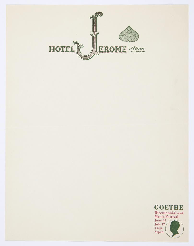 """Letterhead for the Hotel Jerome featuring logo, """"HOTEL JEROME"""" in decorative green and red text; incorporates a stylized letter """"J"""" with curving serifs. A green Aspen leaf with the text """"Aspen / COLORADO"""" below appears slightly above and to the right of """"HOTEL JEROME."""" At lower right, green silhouette profile surrounded by circle and printed text; printed in green: GOETHE; in red, directly below: Bicentennial and / Music Festival / June 27– / July 17 / 1949 / Aspen."""