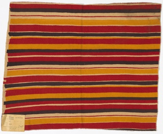 Irregular horizontal stripes of red, dark yellow and dark purple on a beige slubbed foundation fabric.