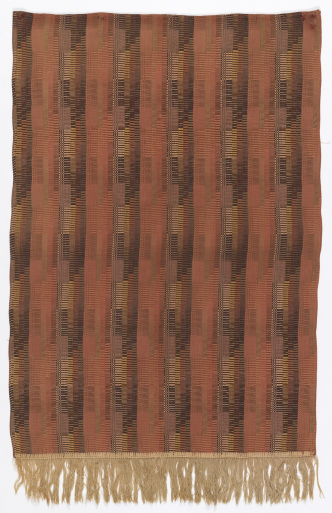 Woven length with a vertical stripes in a shifting stripe pattern of dark orange, salmon pink, yellow, olive green, and black. Off-white fringe at bottom.