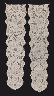 Pair of needle lace cap streamers with an asymmetrical floral pattern, with scalloped edges formed by curving leaves.
