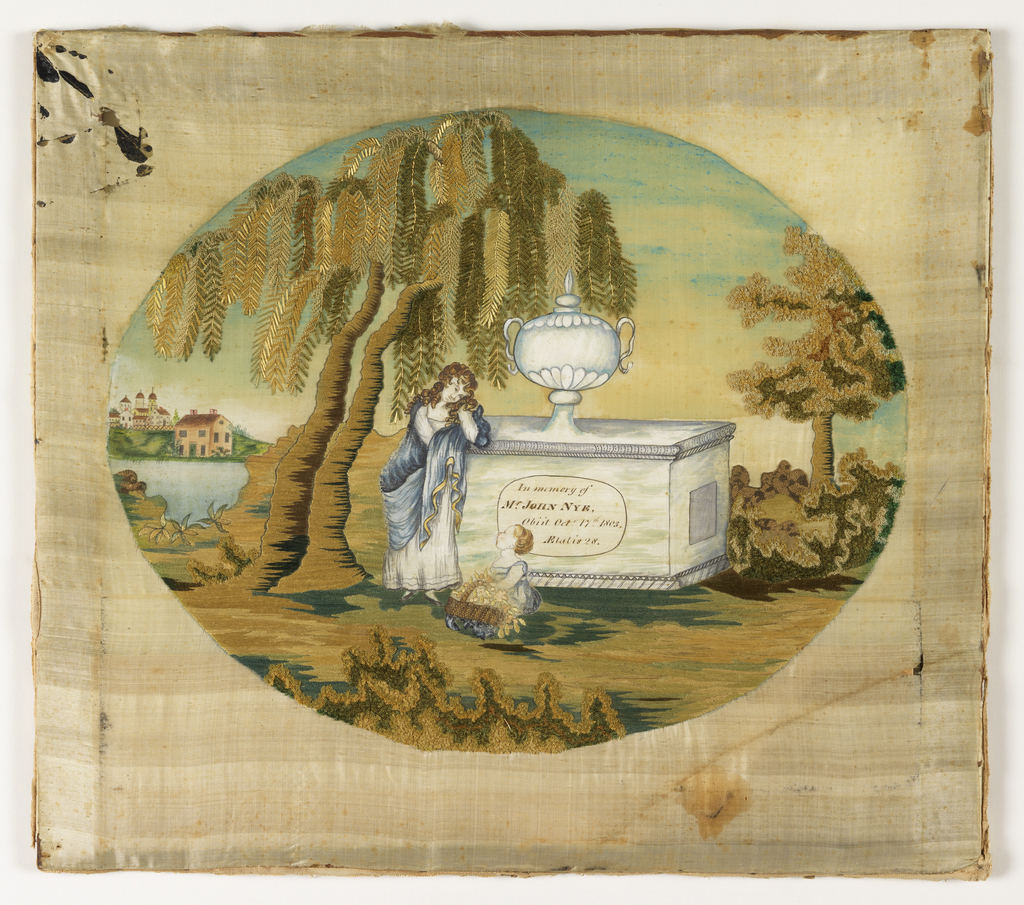 An oval scene of a woman leaning on a tomb; a child with a basket of flowers is seated in front. The inscription on the tomb reads:  In Memory of Mr. John Nye Obiit (sic) Oct 17 1803 Aetatis 28   There is a large weeping willow on the left and a distant landscape of water and a town beyond. Only the trees, grass and shrubbery are embroidered; the rest is painted.