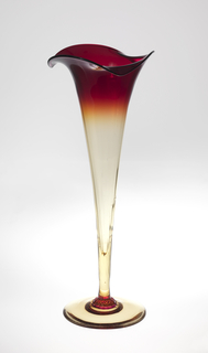 Large trumpet form; shaped deep red rim tapering to clear yellow-amber-ochre colored body and circular foot.