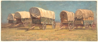 Horizontal rectangle.  Oblique view of five wagons standing on grass. Blue sky.