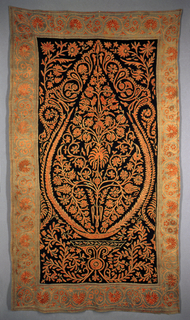 Vertical panel with a black center field embroidered with a symmetrical design of somewhat sparse floral cone rising from a base. Embroidered in coarse orange wool chain stitch and outlined in white. Blue-green border with continuous scrolling floral border.