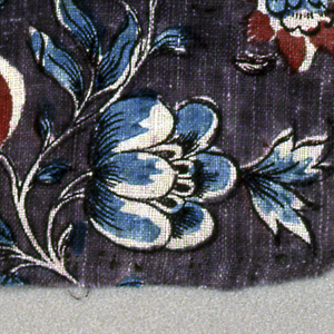 Four fragments of a floral pattern in black, red and blue on a deep purple background.