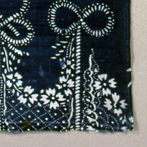 White pattern on blue background. Rows of swags held up by tassels with a flower in the dip of each swag.