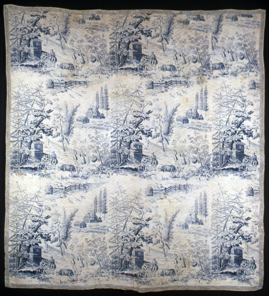 Large quilted bedcover of cream-white cotton plate printed in blue. Design shows a landscape; in the foreground, at left, under a cluster of trees, a man plays a pipe while another leans on a long stick, listening. In front of these two figures are grazing cattle and sheep. Behind the two men, on a road, a man and a woman leading a small boy pass by. Farther down the road is a man with a basket on his head. Beyond the fence on the side of the road is a park with a deer and an orchard. In the far background are two large houses with tall pines behind them. Bedcover is edged with a narrow printed border and is lined with plain white cotton and interlined. Quilting is in a simple zigzag pattern.