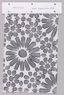 Sample of white jersey appliquéd with metallic silver printed jersey in a pattern of large and small flower heads. Petals are secured to the foundation using a running stitch and are secured with knots. Knots are trimmed with excess thread remaining to form a surface texture.