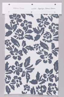 Sample of white jersey appliquéd in a floral design using dark blue jersey.