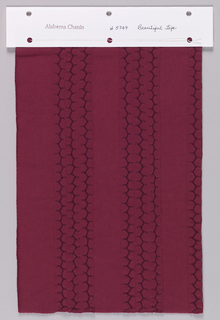 Sample of dark red jersey with appliqué stripes of the same material stitched down using a honeycomb stitch in dark red thread.