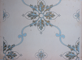 """Medallions formed of acanthus-like leafs, printed in gold and blue, with medallions joined by blue C-scrolls, printed on cream ground. Pattern number """"3528"""" printed in selvedge."""