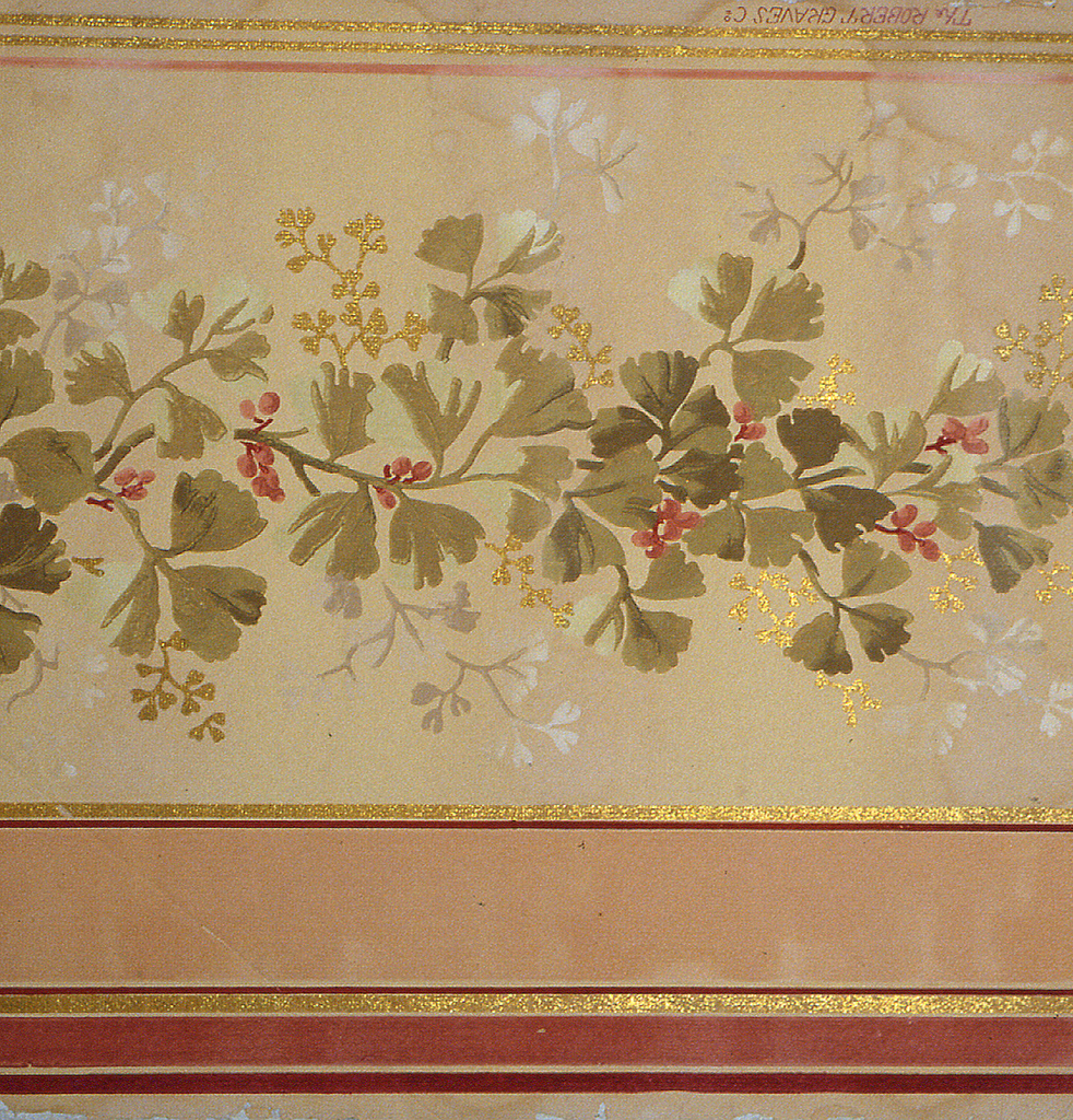 "Border design on embossed paper, three coral-colored stripes on top in varied widths between gold mica bands. Field of design portion is deep ivory. Design is a continuous vine - leaves in soft faded olive greens with coral colored berries, twigs of vine in soft gray-ivory and gold mica. One narrow soft coral stripe at bottom, below which are two narrow gold mica stripes. ""Robert Graves Co."" printed on outer edge."