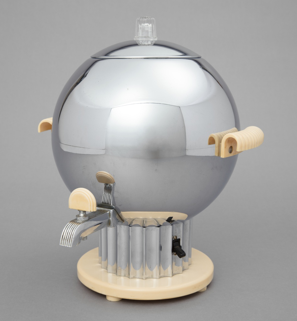 """Spherical coffee maker (a) having small nozzle on lower front with arched white plastic spigot (c); curved ridged white plastic handles on left and right; domed chrome lid (b) with clear ridged knob at top; fluted columnar chrome base on circular white plastic foot; """"HIGH/LOW"""" switch on right side of column, prongs for electrical cord on back."""