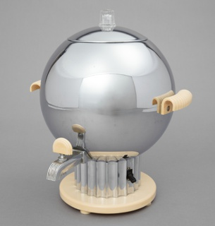 "Spherical coffee maker (a) having small nozzle on lower front with arched white plastic spigot (c); curved ridged white plastic handles on left and right; domed chrome lid (b) with clear ridged knob at top; fluted columnar chrome base on circular white plastic foot; ""HIGH/LOW"" switch on right side of column, prongs for electrical cord on back."