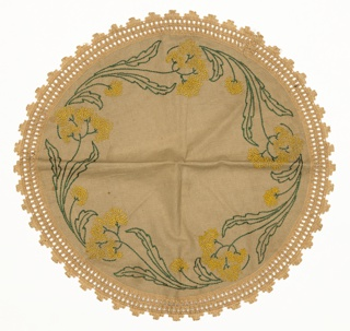 Light brown table round with an embroidered border of yellow flowers and dark green leaves. Yellow flowers are made from knot stitches while leaves and stems are embroidered using stem stitches in dark green. Matching light brown border trim.