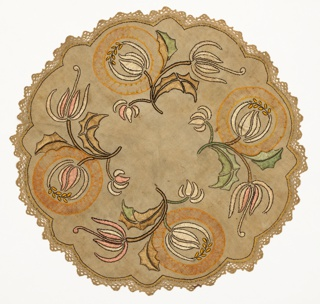 Light brown table round with scalloped edges has a stylized, spiky floral forms embroidered in shades of pale pink, light green, light brown, off-white, and orange. Crocheted border.