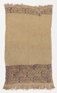 Narrow tunic with a printed design of stylized flowers in blue and pale pink.