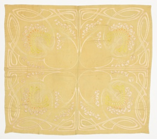 Buff-colored tablecloth with a scrolling Art Nouveau border design that forms four compartments containing stylized floral elements. Embroidery in off-white with some areas of yellow-green and orange.