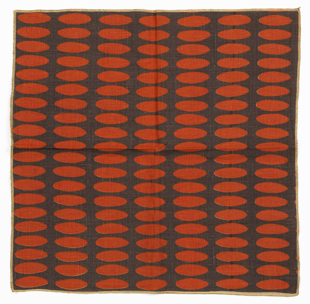 Printed length has bands of red-orange ovals on a dark grey ground.