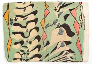 Mint green pillowcase has black and white biomorphic forms with blue leaves and meandering yellow and pink ribbon-like forms.