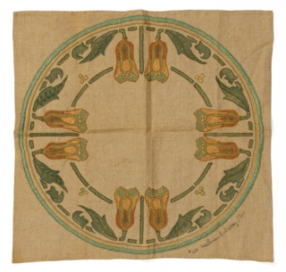 Sqaure table cover with a symmetrical border arrangement of pairs of leafy blossoms in shades of green and orange.