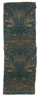 Narrow curtain panel with peacocks and dragons in various shades of blue and orange, dark green, and beige.
