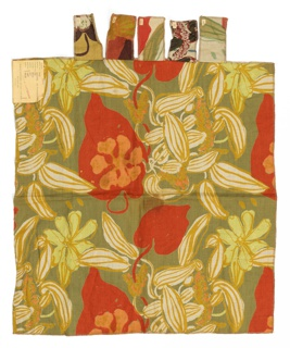 Sample of printed fabric has a floral design of yellow-green flowers, white and red leaves on an olive green ground.