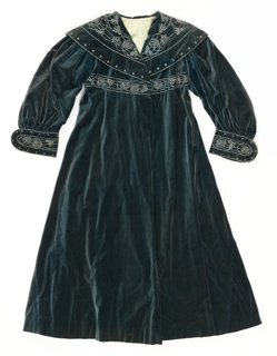 Blue-grey velvet gown with grey embroidered floral design around the collar, waist and cuffs.