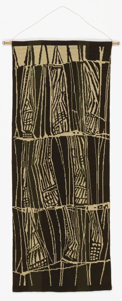 Wall hanging in black, olive green and off-white has a design of stacked compartments containing abstracted angular forms separated by slanting lines.