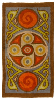 Celtic-revival rug with a large central medallion containing a motif made of five concentric circles. Two circles with spirals at either end flank the central medallion. Curling strapwork fills the spaces between. In blue-grey, dark red, dark orange, dark yellow, beige, brown, and yellow-green.