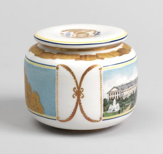 Cylindrical form (a), rounded at base and top, disk-shaped lid (b); painted in polychrome enamel, gilt ribbon border around top of body, and emblem on lid with the date 1935 in blue. Painted on the front with polychrome enamel picture of a white building [Smolney?] of two storeys with fountains on the left and right; the back with gilded image of the Pushkin Theatre, formerly Alexandrine Theatre or Alexandrinsky, flanked by trees.
