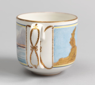 Cylindrical cup (a), rounded at base, loop handle; painted on front in polychrome enamels with picture of the Peter and Paul Fortress and Kirovsky (Troitsky) Bridge over Neva River, back has gilded image of Egyptian sphinx from Embankment at University Wharf. Saucer (b) has gilded ribbon border around outer edge.