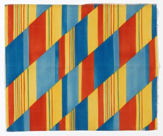 Length of printed fabric with diagonal bands consisting of vertical stripes of varied thickness in shades of blue, red-orange, yellow and green.