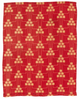 Length of woven red fabric has a design of triangles made from stacked squares in pale yellow. Thin yellow lines connect the triangular forms.